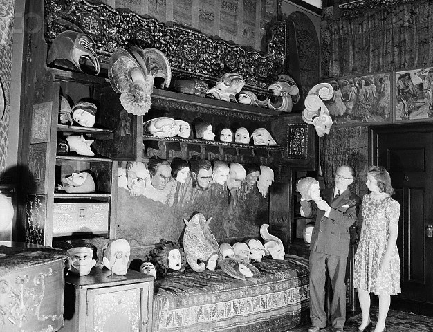 W.T. Benda and Daughter Among His Masks